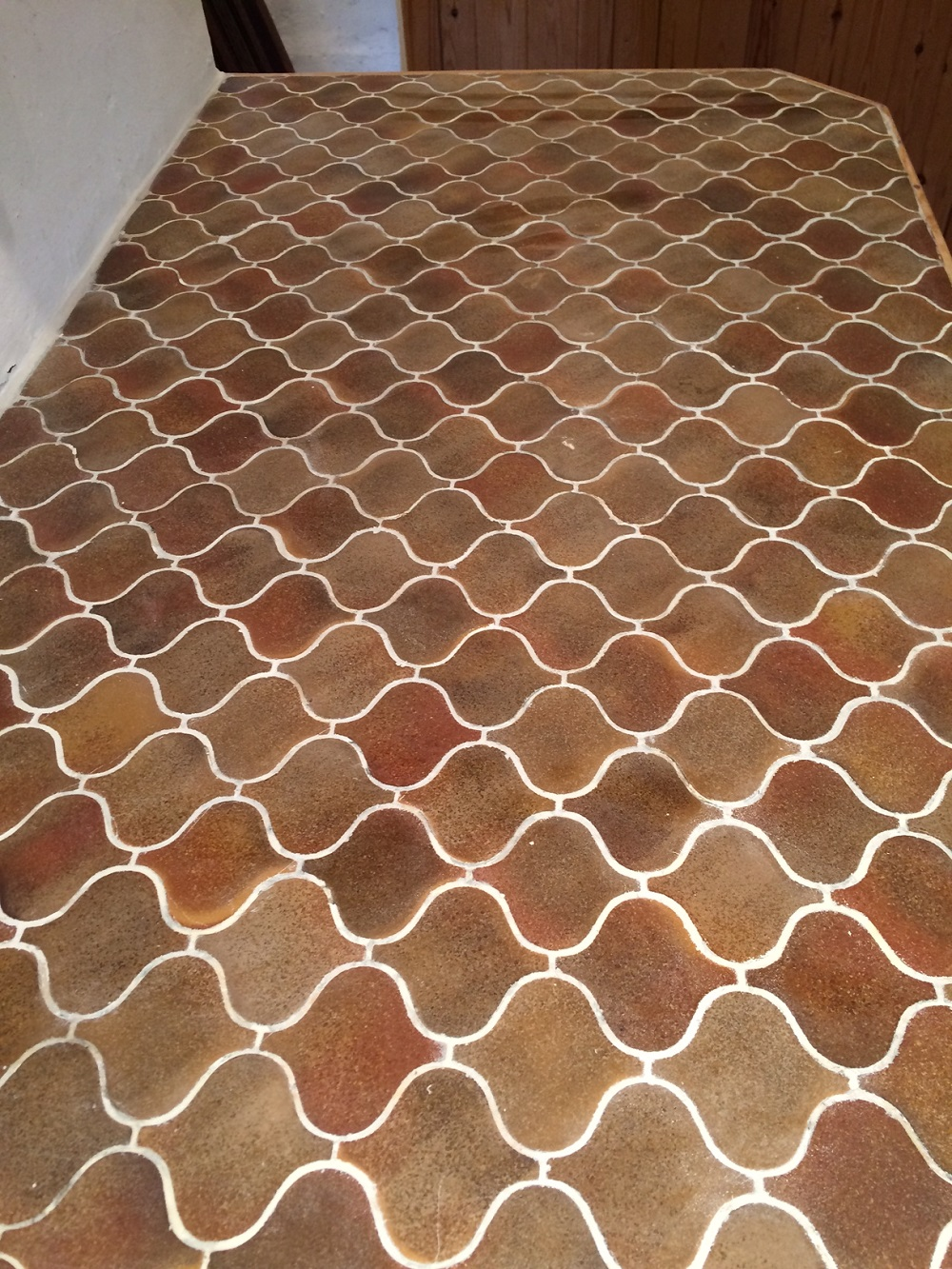 Mosaic tiled worktop after grout colouring
