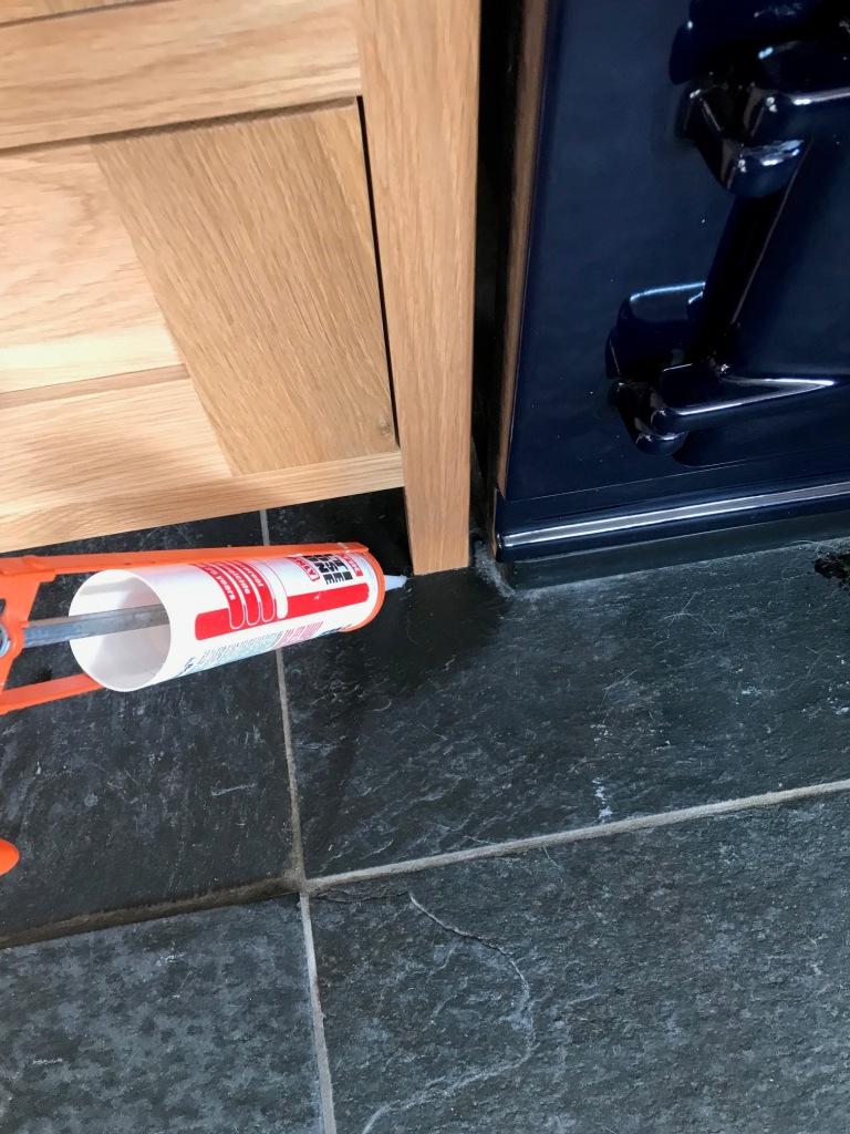 Rough Black Slate Floor Applying Silicone Bentham