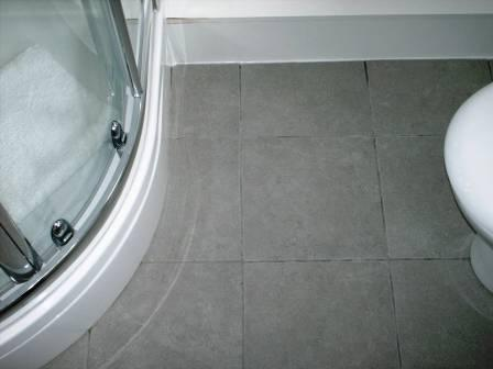 Ceramic Tiled Bathroom Floor Before Grout Colouring